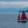 Red sails and volcano