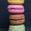 Colorful macarons on a black wood