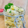 Potato salad in a jar on wooden