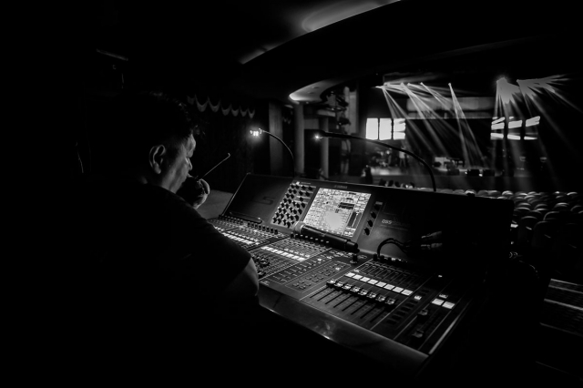 The soundman, behind the stage