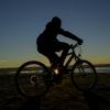 biking into the sunset